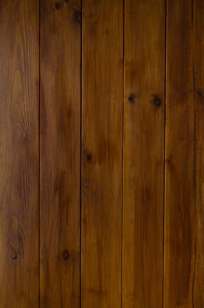tongue and groove: A photographed background texture of dark wood tongue and groove planking.