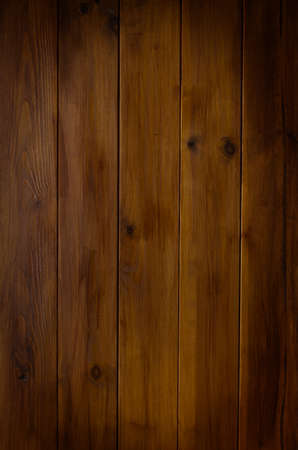 tongue and groove: A photographed background texture of dark wood tongue and groove planking with vignette applied.