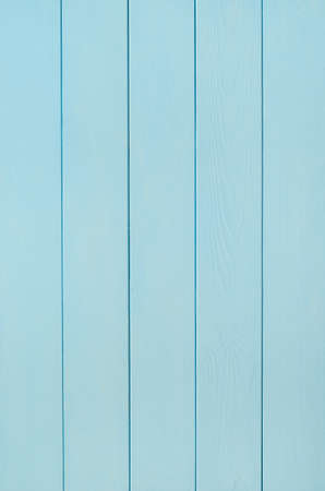 tongue and groove: a tongue and grooved wood plank panel, painted in a pale cool blue. Stock Photo