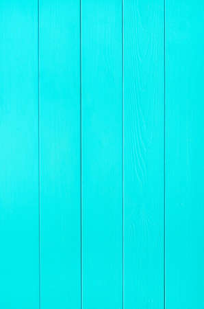 tongue and groove: a tongue and grooved wood plank panel, painted turquoise blue.  Shot vertically.