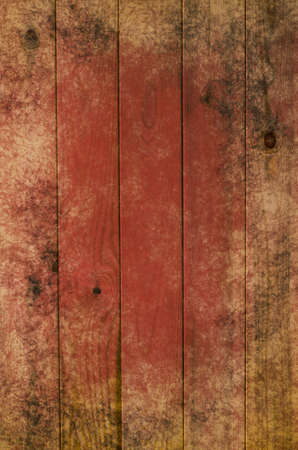 powdery: Photograph of wood planking, processed to give a red tint and a weathered, grungy appearance of a border of powdery sand, grubby marks, fading and discolouration.