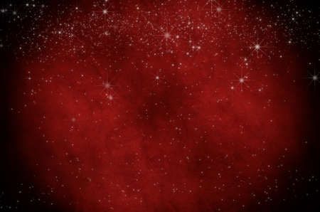 A Christmas background texture.  White stars sprinkled across dark red parchment with vignette.  Greater star density across top edge. photo