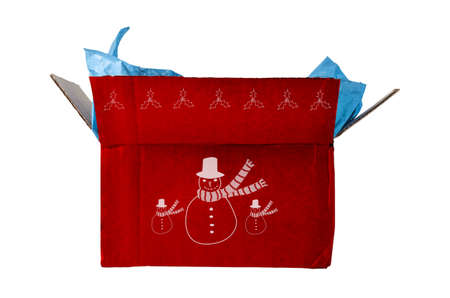 corrugated box: An opened corrugated cardboard box, decorated for Christmas with red hues and white illustrations of snowmen and holly leaves and berries. Open flaps reveal pale packing tissue paper, poking out at the top. Isolated on white background.