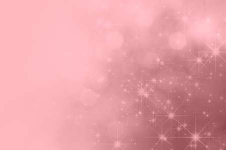 fading: A festive pink background with bokeh and sparkling stars, fading towards solid colour copy space on the left side.