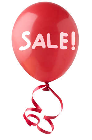 A single red balloon, tied with curly red ribbon, with the word SALE! handwritten in white.  Isolated on white background. photo