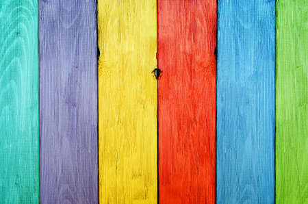 hues: Vibrant, bright wooden fence with each plank a different colour.