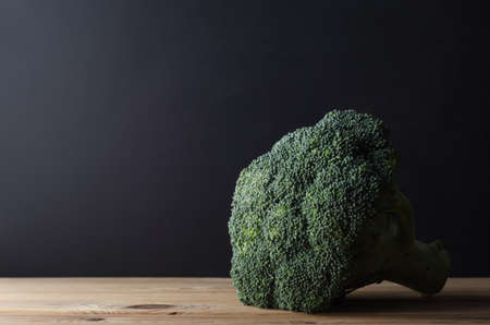 intact: A head of dark green broccoli with stalk intact