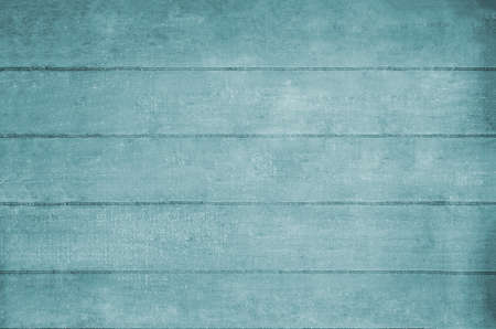 hues: Wooden plank background texture in pale blue hues.