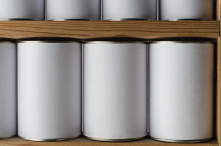 unbranded: Rows of tin cans with unbranded, blank white labels, on wooden shelves.