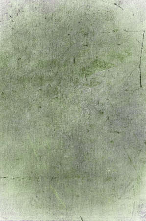 Grungy old scratched background texture. Green, grey and white hues.