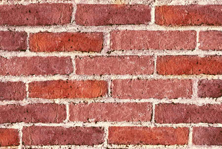 Brick wall background texture filling frame.