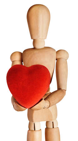 Wooden artists mannequin, facing front and holding out a large, soft red heart in both hands. Isolated on white background.