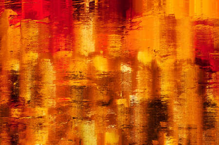 Shining, warm, yellow, amber, gold and orange abstract background texture. Appearance of lights reflected in wet surface. Painterly effect. Zdjęcie Seryjne