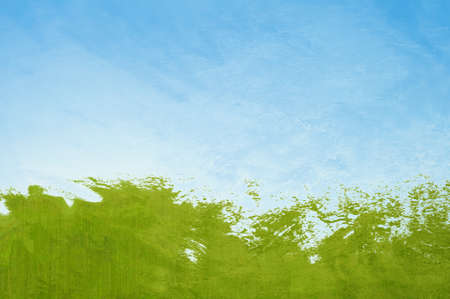 Abstract painterly background resembling green grass splashing as if waves under a blue sky with wispy clouds. Zdjęcie Seryjne