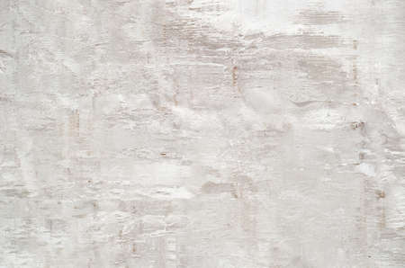 Abstract background of worn and dilapidated appearance. Warm white with a pink hue and woody elements in the texture.