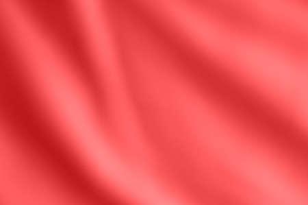 Softly draping blurred satin fabric in a warm coral pink hue. Zdjęcie Seryjne