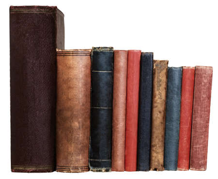A row of old books in different colours and sizes, isolated on a white background. Blank spines facing viewer at eye level.