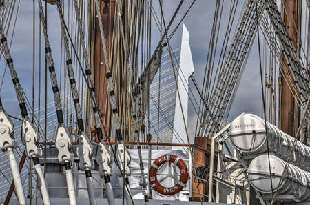 Rotterdam, The Netherlands, August 9, 2017: Erasmus Bridge in conjunction with four-masted Peruvian navy ship Bap Union, moored at Wilhelminapier