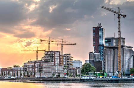 Rotterdam, The Netherlands, July 16, 2018: several construction cranes are transforming the neighbourhood of Katendrecht