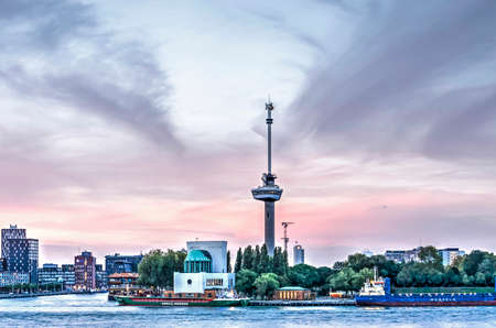 Rotterdam, The Netherlands, October 12, 2018: spectacular sky at sunset over Maastunnel ventilation building, Euromast observation tower, Park Quay and The Park