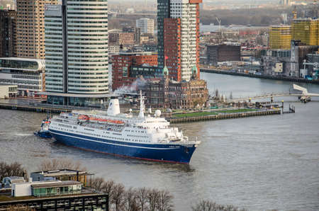 Rotterdam, The Netherlands, December 10, 2018: cruiseship Marco Polo passes hotel New York shortly after leaving the cruise-terminal at Wilhelmina Pier Editorial