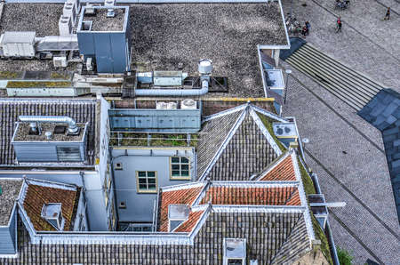 Rotterdam, The Netherlands, September 10, 2017: Aerial view of houses with a combination of flat roofs, a patio and pitched roofs witn tiles in various colors