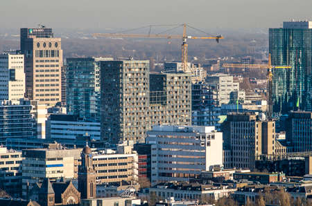 Rotterdam, The Netherlands, January 2019: part of the Rotterdam skyline as seen from the west including Karel Doorman residential building and the world trace center