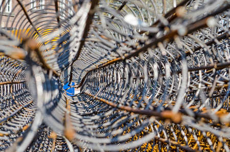 View through a pile of tubular reinforcement nets on a sunny day on a construction site