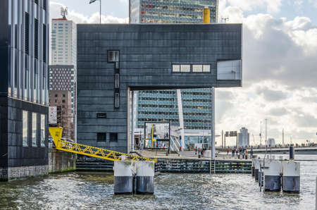 Rotterdam, The Netherlands, February 3, 2019: black cladded facade of the sculptural modern of several bridges across the Nieuwe Maas river