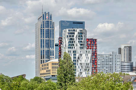 Rotterdam, The Netherlands, June 2, 2019: view across the treetops at Westersigenl canal towards the highrise of Central district
