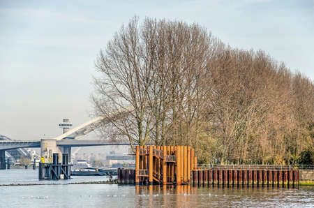 Rotterdam, The Netherlands, November 24, 2019: view across the water towards the new viewing platform on Brienenoord island with  Brienenoord bridge in the background