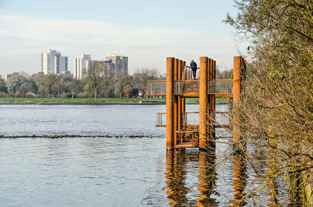 Rotterdam, The Netherlands, November 24, 2019: the new corten steel viewing platform on Brienenoord island overlooking the river Nieuwe Maas and the opposite bank.