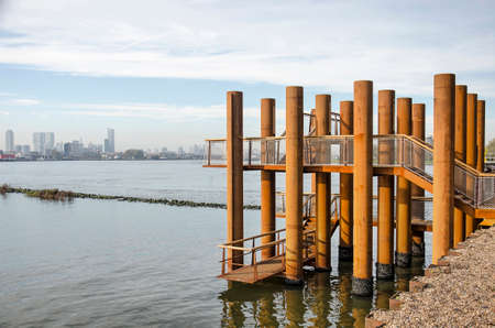 Rotterdam, The Netherlands, November 24, 2019: the new corten steel viewpoint on Brienenoord island with the river and the city's skyline in the background