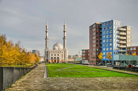 Rotterdam, The Netherlands, November 24, 2019: the Essalam mosque with adjacent park and modern residential buildings