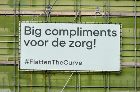 Rotterdam, The Netherlands, April 12, 2020: big sign on building site opposite Erasmus MC hospital saying in English/Dutch: big compliments for healthcare workers Editorial