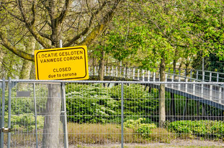 Rotterdam, The Netherlands, April 12, 2020: Fence and sign closing Museumpark as part of municipal covid-19 measures