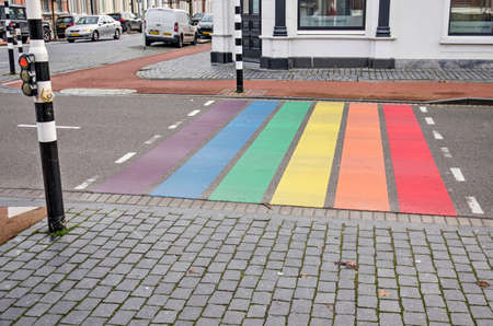Bergen op Zoom, The Netherlands, December 29, 2019: pedestrian crossing in rainbow colors, celebrating lgbt rights, at the junction of Stationsstraat and Wassenaarstraat Editorial