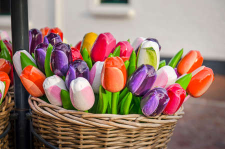 Renesse, The Netherlands, February 18, 2020: Basket with colorful collection of artificial tulips, sold in a souvenir shop Editorial