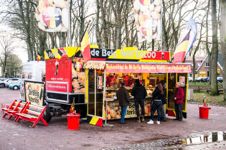 Zuidlaren, The Netherlands, December 8, 2019: Stall on the town square in colors of the Belgian flag, selling the popular Begian/Flemish fries Editorial