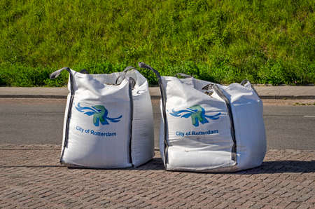Rotterdam, The Netherlands, April 21, 2020: two large sandbags used by the municipality to close a location as part of covid-19 measures Editorial