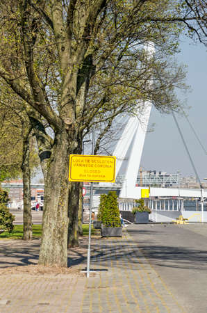 Rotterdam, The Netherlands, April 21, 2020: Parkkade/Park Quay with yellow sign indicating location is closed due to covid-19 measures
