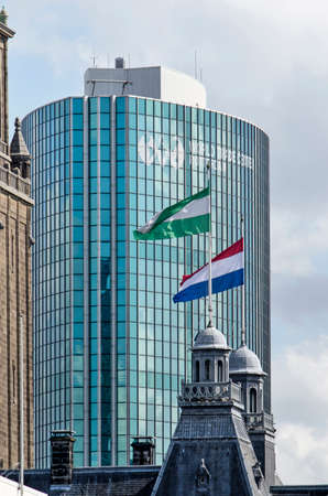 Rotterdam, The Netherlands, April 5, 2020: the Dutch and Rotterdam flag on the city hall with the World Trade Center in the background