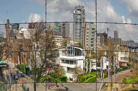 Rotterdam, The Netherlands, March 14, 2020: the city's skylien including Chabot museum, Park hotel, Arminius church reflecting in the facade of the new Boymans depot building Editorial