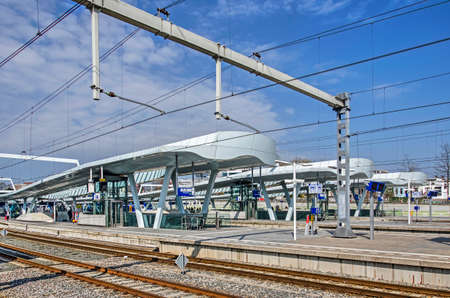 Arnhem, The Netherlands, March 30, 2019: several platforms and tracks at the recently completed central railway station under a blue sky Editorial
