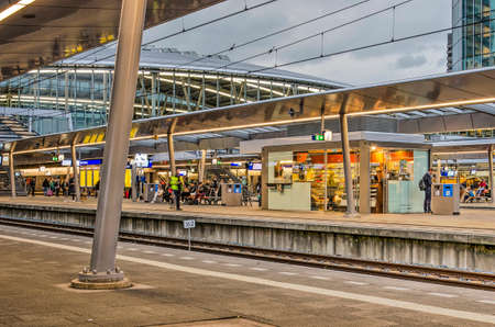 Utrecht, The Netherlands, October 13, 2019: platforms at the recently modernized central railway station during evening twilight