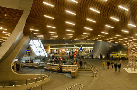 Arnhem, The Netherlands, December 27, 2019: the central hall of the sculptural new railway station with fast food outlets and wooden ceiling