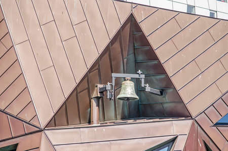 Rotterdam, The Netherlands, April 26, 2020: the bell of Pauluskerk (Saint Paul's church) with its irregular volume of copper-cladded triangles Editorial