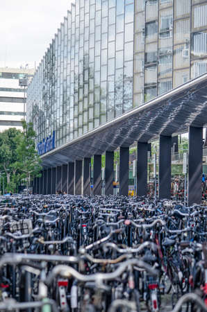 Rotterdam, The Netherlands, May 15, 2020: endless rows of bicycles parked at the rear entrance of the central railway station