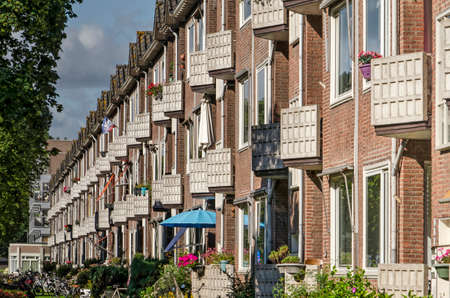 Zwolle, The Netherlands, July 28, 2020: brick housing block from the mid 20th century with repetitive concrete balconies in Wipstrik neighborhood