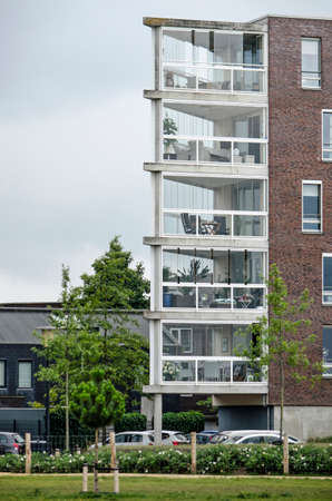 Zwolle, The Netherlands, August 2, 2020: residential building in Stadshaven neighborhood with triangular closed verandas